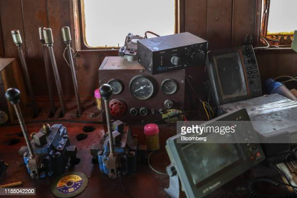 Navigation equipment sits in the cabin of a fishing trawler in Quang Nam Vietnam on Wednesday June 26 2019 Fishermen are on the front lines of Asias...