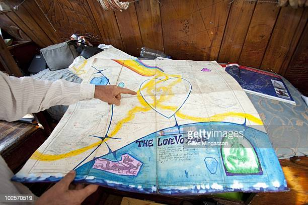 A navigation map shows some of American sailor Reid Stowe's route during1152 days at sea at the helm of his handbuilt weathered wooden 70 foot...