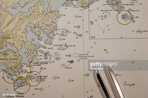 Navigational charts and tools lay on a table in the control room onboard CMA CGM SA's Benjamin Franklin container ship as it sails from Xiamen to...