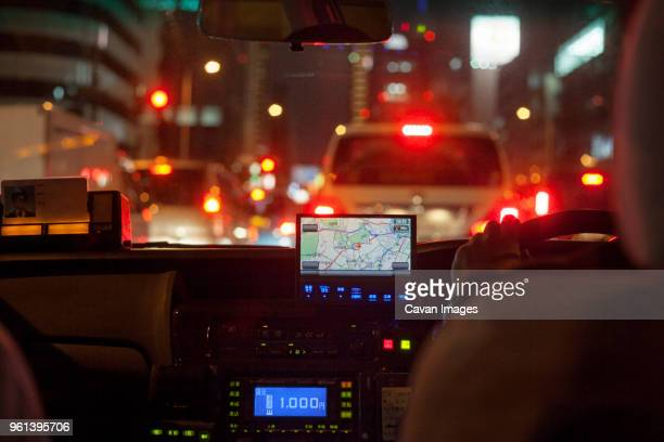 GPS navigational system on dashboard of taxi