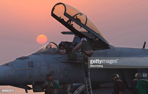 Navigator climbs out of a Boeing F/A-18 Super Hornet on the American aircraft carrier USS Enterprise on Friday, Aug. 24, 2007. The USS Enterprise is...