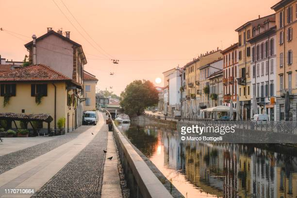 navigli canals at sunrise, milan, italy - milan stock pictures, royalty-free photos & images