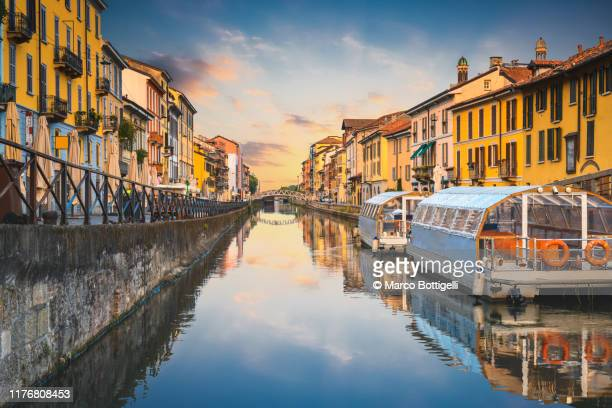 navigli canals in the old town at sunset, milan, italy - milan stock pictures, royalty-free photos & images
