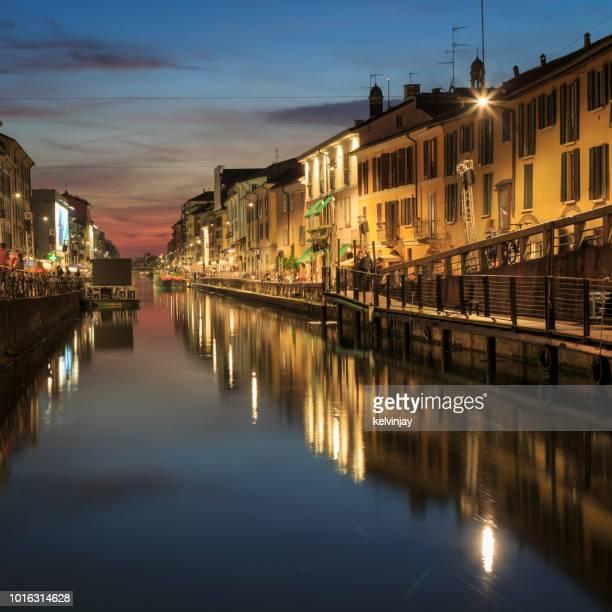 naviglio grande -  bars, cafes and restaurants in the beautiful navigli district in milan, italy - navigli milano foto e immagini stock