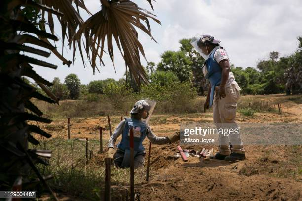 Navirethan Sujitha supervises another de-miner working at Muhamalai, one of the biggest minefields in the world, on March 2, 2019 in Muhamalai, Sri...