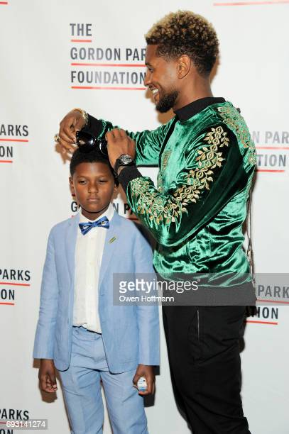 Naviyd Ely Raymond and singersongwriter Usher attend the Gordon Parks Foundation Awards Dinner Auction at Cipriani 42nd Street on June 6 2017 in New...