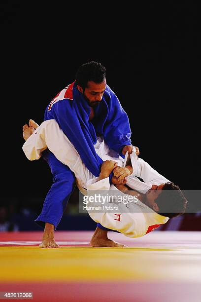 Navjot Chana of India competes against Ashley McKenzie of England in the Men's 60kg Gold medal contest at SECC Precinct during day one of the Glasgow...