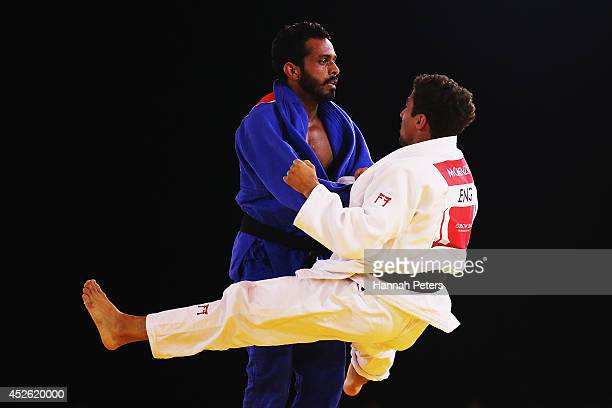 Navjot Chana of India competes against Ashley McKenzie of England in the Mens 60kg Gold medal contest at SECC Precinct during day one of the Glasgow...