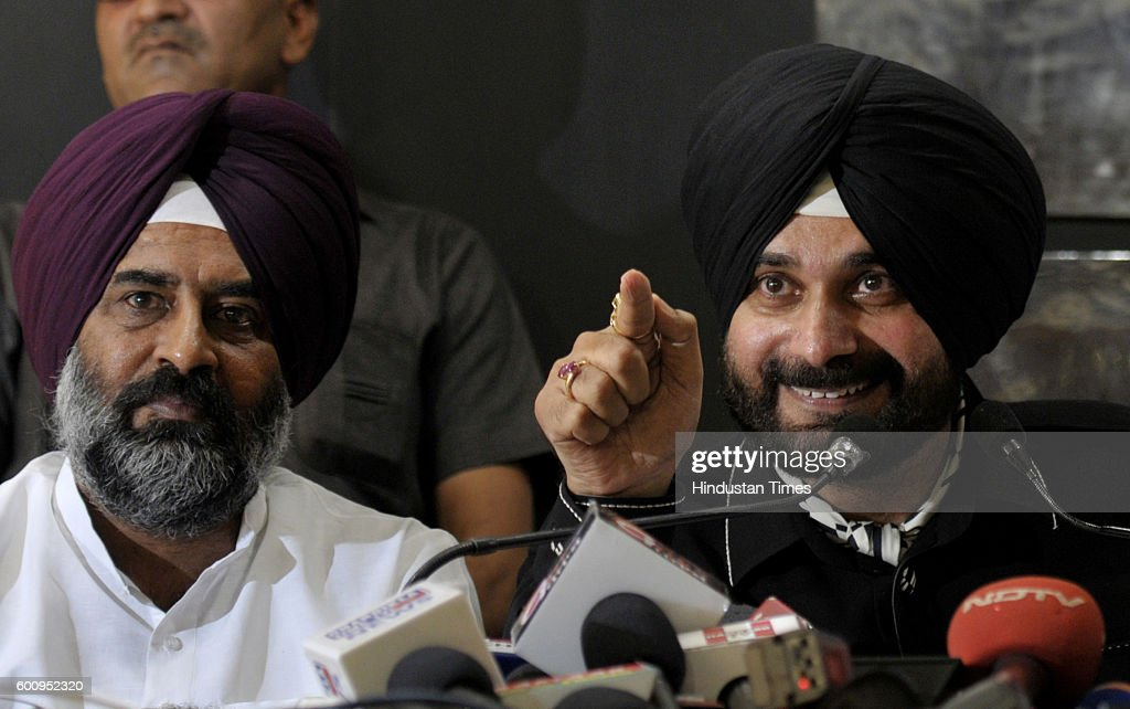 Navjot Singh Sidhu along with MLAs Pargat Singh and Balwinder Singh Bains during a press conference at Chandigarh Press Club in sector 27 on...