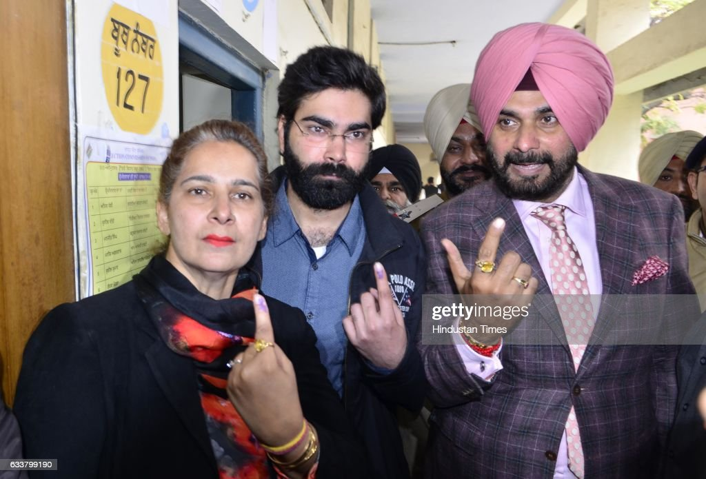 Navjot Singh Sidhu Congress candidate from East Constituency with his wife Navjot Kaur Sidhu and son Karan Sidhu showing his inked finger after...
