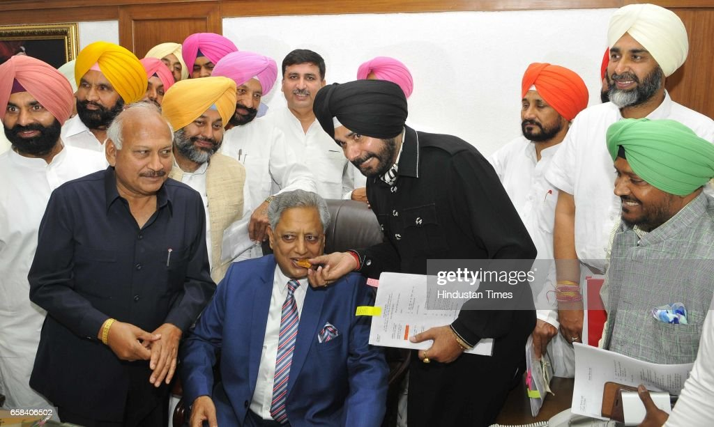 Navjot Singh Sidhu offering sweets after the newly elected Punjab Speaker Rana KP Singh took charge at Punjab Vidhan Sabha on March 27 2017 in...
