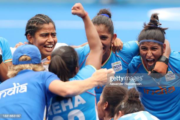 Navneet Kaur and Navjot Kaur of Team India celebrate their 1-0 win with teammates after the Women's Quarterfinal match between Australia and India on...