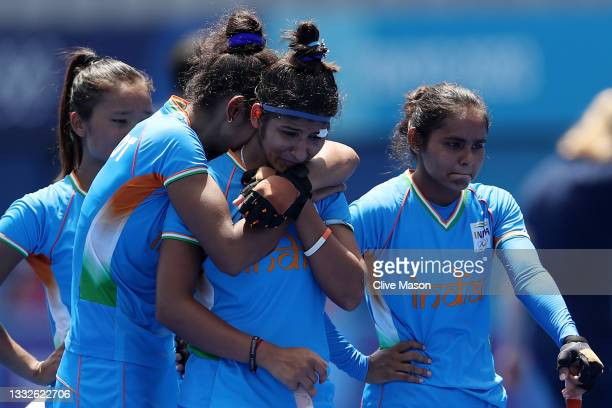 Navneet Kaur and Nisha of Team India react following their loss in the Women's Bronze medal match between Great Britain and India on day fourteen of...