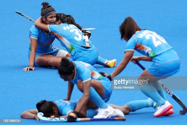 Navneet Kaur, Neha Neha and Lalremsiami of Team India celebrate their 1-0 win with teammates while Karri Somerville reacts after the Women's...