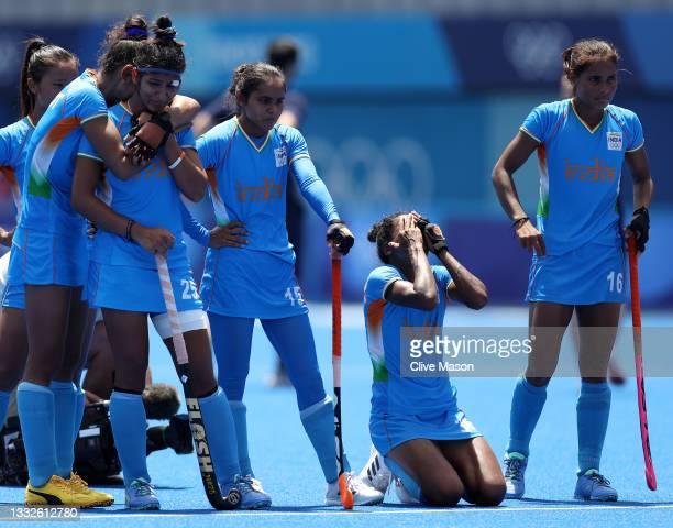 Navneet Kaur, Nisha, Salima Tete, and Vandana Katariya of Team India react following their loss in the Women's Bronze medal match between Great...
