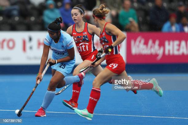 Navneet Kaur of India gets away from Erin Matson of USA and Alyssa Manley of USA during the Pool B game between India and USA of the FIH Womens...