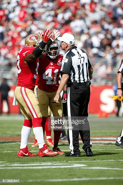 NaVorro Bowman and Antoine Bethea of the San Francisco 49ers argue a noncall with official Terry McAulay during the game against the Dallas Cowboys...