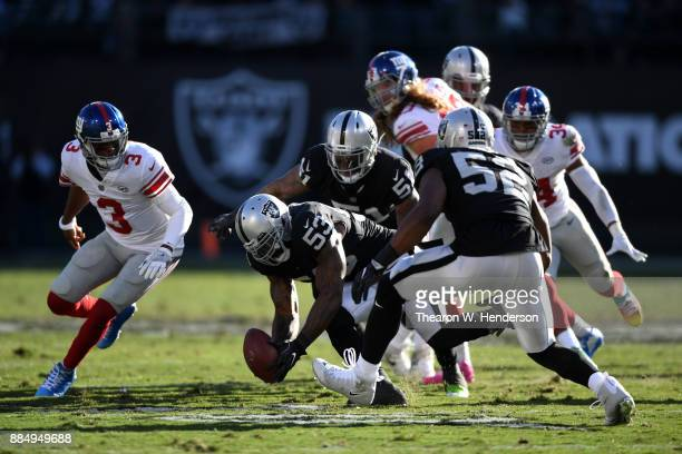 NaVorro Bowman of the Oakland Raiders recovers a fumble by Geno Smith of the New York Giants during their NFL game at OaklandAlameda County Coliseum...