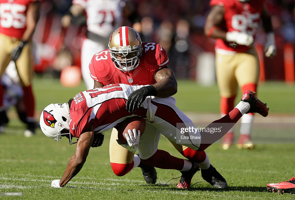 NaVorro Bowman #53 of the San Francisco 49ers tackles Andre Roberts #12 of the Arizona Cardinals at Candlestick Park on December 30, 2012 in San Francisco, California.