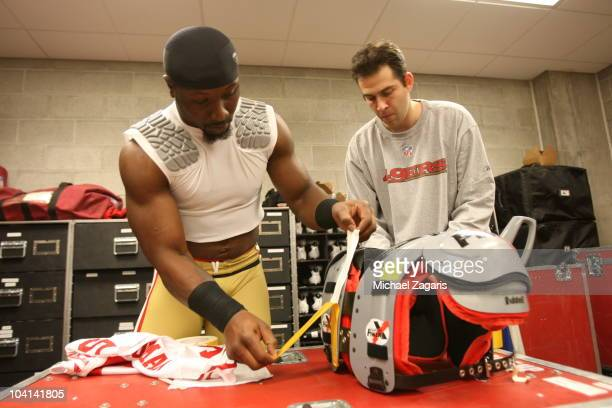 NaVorro Bowman of the San Francisco 49ers works on his pad in the locker room prior to the season opener against the Seattle Seahawks at Qwest Field...