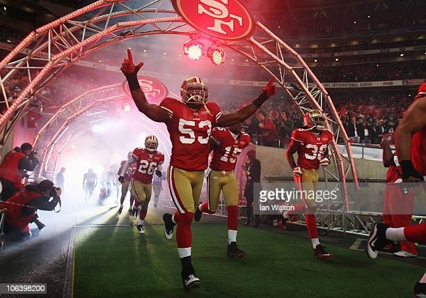 NaVorro Sopoaga of San Francisco 49ers emerge from the players tunnel with team mates before the NFL International Series match between Denver...