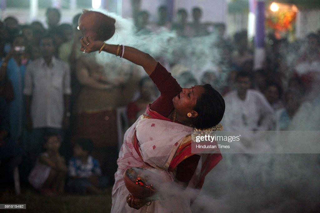 Navratri Garba Durga Puja A woman performing traditional Bengali ritual dance at a Durga Mandap on occasion of Durga Asthami at the Shivaji Park Dadar