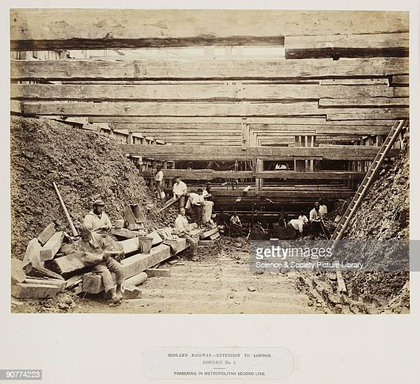 Navvies working on the Metropolitan Railway line during the construction of the Midland Railway's extension to St Pancras The cutting has been shored...