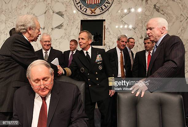 Navy Adm Eric Olson commander of the US Special Operations Command greets Sen Joe Lieberman while Sen John McCain and Sen Carl Levin stand nearby...