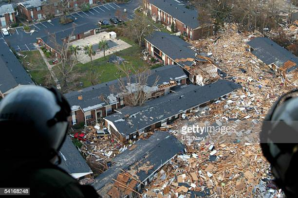 Navy air crewmen, assigned to Helicopter Support Unit Pensacola, survey the damage from hurricane Katrina en route to Stennis Space Center,...