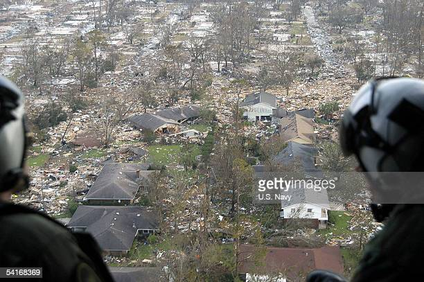 S Navy air crewmen assigned to Helicopter Support Unit Pensacola survey the damage from hurricane Katrina en route to Stennis Space Center...