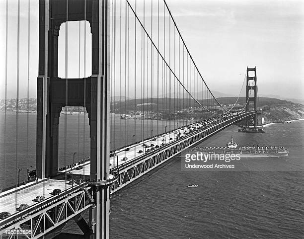 Navy aircraft carrier going under the Golden Gate Bridge during opening day ceremonies for traffic on the bridge San Francisco California May 28 1937