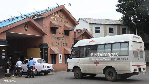 A navy ambulance going inside Lion Gate at Naval dockyard where explosions occurred in INS Sindhurakshak submarine on August 16 2013 in Mumbai India...