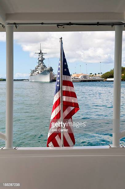 u.s. navy and american flag in pearl harbor hawaii - hawaii flag stock pictures, royalty-free photos & images