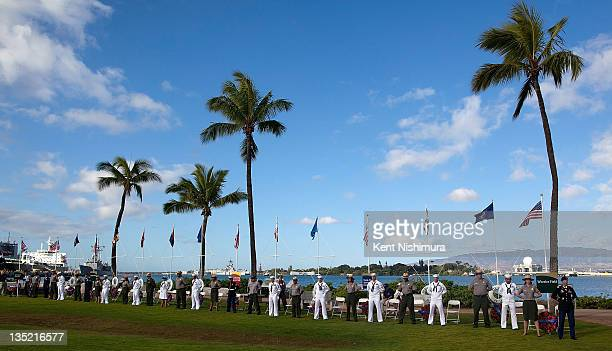 Navy and Park Service Personnel stand at attention during a memorial service for the 70th anniversary of the attack on the U.S. Naval base at Pearl...