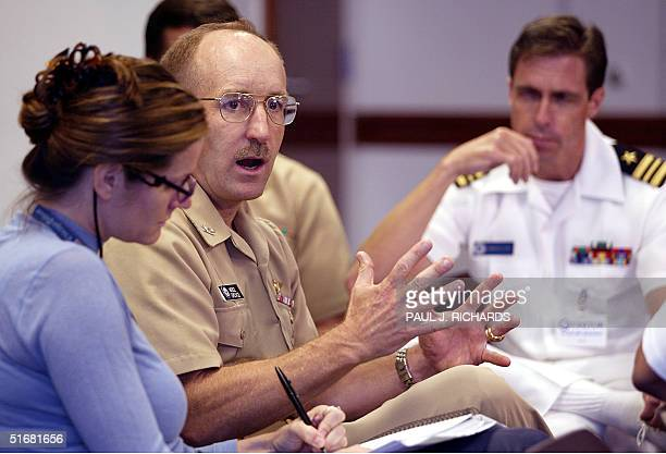 Navy and Pentagon attack survivor US Navy Captain Jim Spence is interviewed by a reporter 29 August 2002 inside the Pentagon as journalists work on...