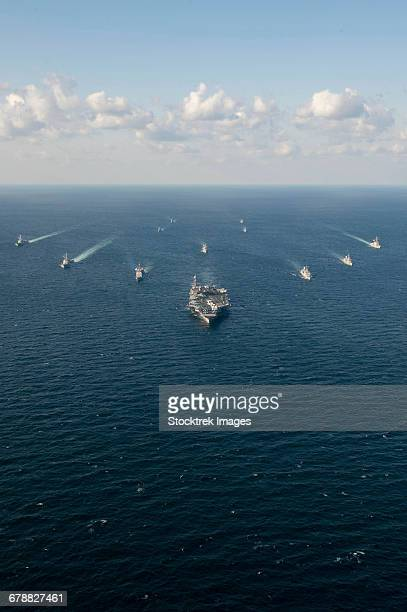 u.s. navy and rok navy ships transit the waters surrounding the korean peninsula. - military convoy stock photos and pictures