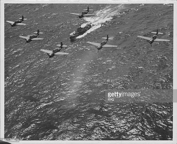 US Navy Avenger torpedo bombers in joint operations with submarine chaser naval vessels during the Pacific Campaign of World War Two circa 19411945