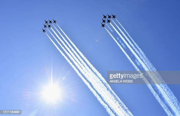 US Navy Blue Angels and US Air Force Thunderbirds jets fly over New York to salute coronavirus healthcare workers first responders and other...
