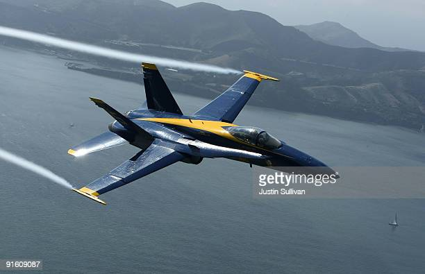 S Navy Blue Angels F/A18 Hornet piloted by US Marine Corps Major Nathan Miller flies over the San Francisco Bay during a practice flight ahead of the...