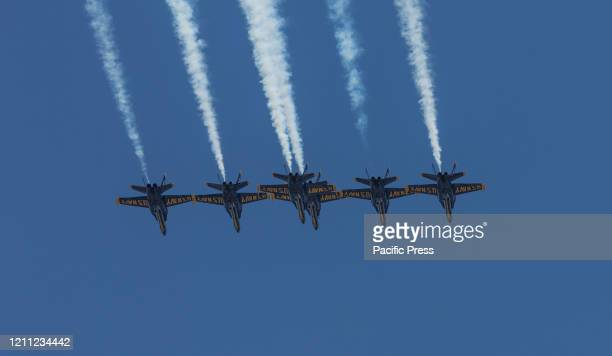 Navy Blue Angels flying in formation over city to pay tribute to honor COVID-19 frontline workers.