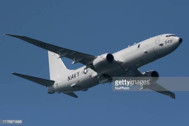 Navy Boeing P-8 Poseidon long-range anti-submarine and maritime reconnaissance plane flies over the San Francisco Bay in San Francisco, California on...