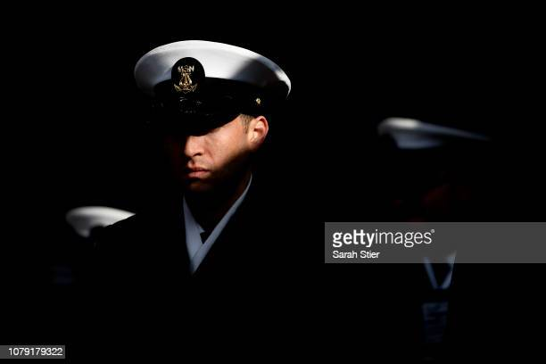 Navy Cadet waits in the tunnel prior to marching on to the field before the start of the game against Army Black Knights at Lincoln Financial Field...