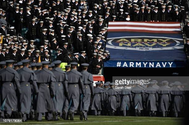 Navy Cadets taunt Army Cadets as they retreat from the field before the start of the game at Lincoln Financial Field on December 08 2018 in...