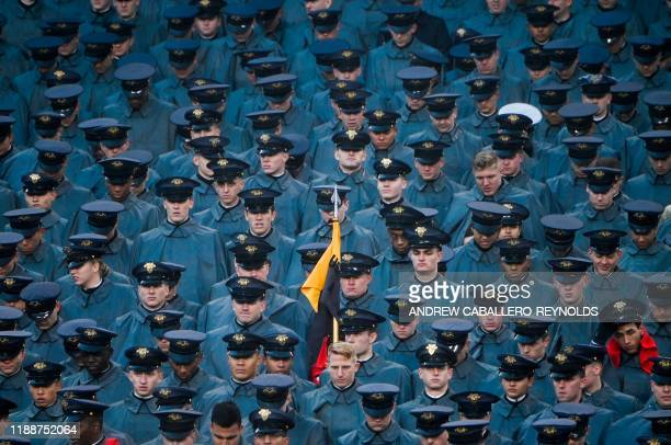 Navy cadets watch as US President Donald Trump attends the ArmyNavy football game in Philadelphia Pennsylvania on December 14 2019
