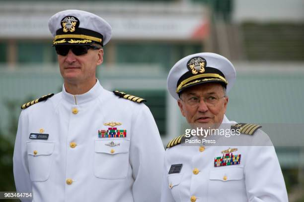 Navy Capt Francis Spencer and Ret Capt Louis A Cavaliere stand during the Memorial Day ceremony onboard the retired USS Olympia which carried home...