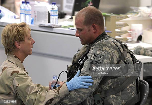 S Navy Captain Anne Lear checks on US Army Staff Sgt James Shields with 101st Airborne Task Force Shadow MEDEVAC when he showed signs of a heat...
