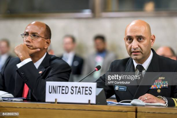 US Navy captain Murzban Morris delivers a speech next to US Permanent Representative to the Geneva conference Robert Wood during a plenary meeting of...