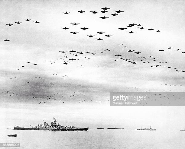 Navy carrier planes fly in formation over the US and British fleets in Tokyo Bay during the Japanese surrender 2nd September 1945 USS Missouri where...