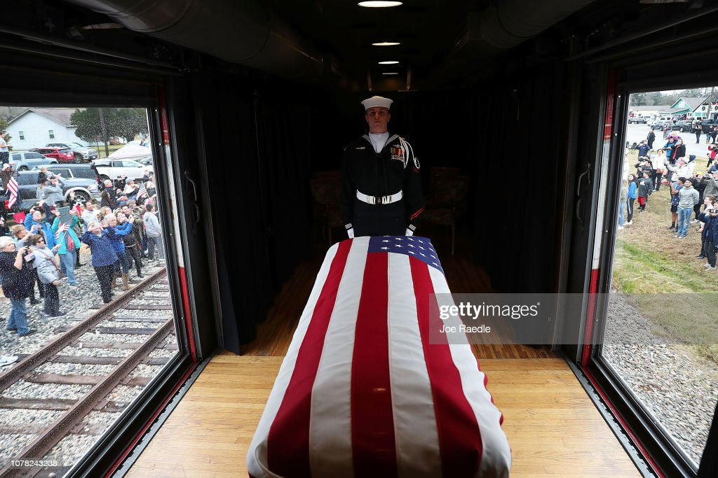 Funeral Train Carries President George H.W. Bush's Casket To Bush Presidential Library In College Station : News Photo