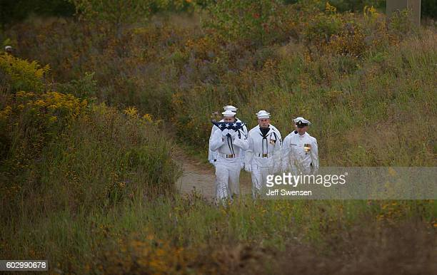 Navy Ceremonial Honor Guard walks with a flag through the field to the Wall of Names at the Flight 93 National Memorial on the 15th Anniversary of...